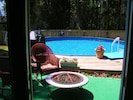 large crystal clear pool, fire pit and gas grill maintained year round