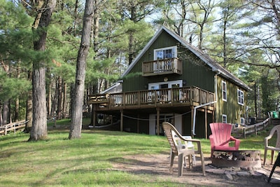Located in the pine trees on lake delton with large main floor deck.