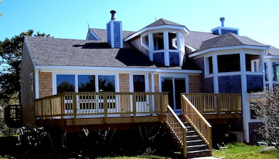 Remodeled exterior  with new addition beyond this south deck shown ..