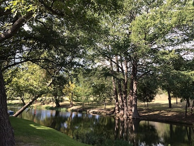 Peaceful private waterfront, both sides of creek. Also the view from front porch