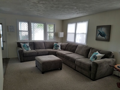 Living room with sectional pull out.