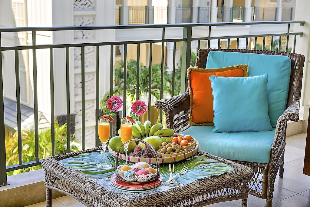 Breakfast on the terrace with chair and blue pillows