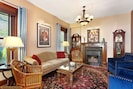 Well-appointed parlor with TV/cable and original fireplace.