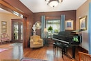The 6-1/2' conservatory grand piano completes the formal parlor.