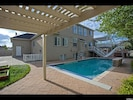 Dine, swim, play, soak up some sun; multiple choices in large yard