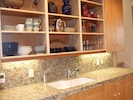 The remodeled kitchen features granite, wonderful appliances and ease of use