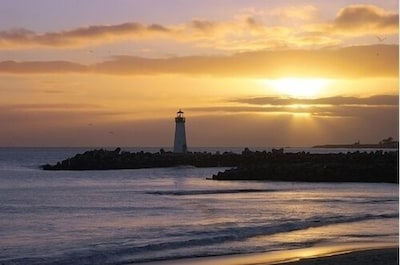 Lighthouse at sunset from Twin Lakes/Harbor beach