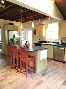 Kitchen with all appliances & wet bar. Fully Stocked. Two dishwashers.