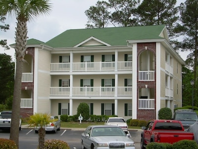 Front View of Condo and Parking Area
