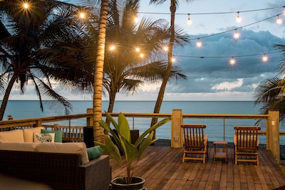 Our hardwood deck sits atop our seawall, offering the ideal Sandy Beach vantage.