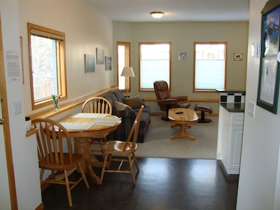 dining nook and living room seen from entry way
