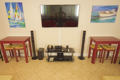 60' plus flat screen, Playstation, Wii, Sound System.