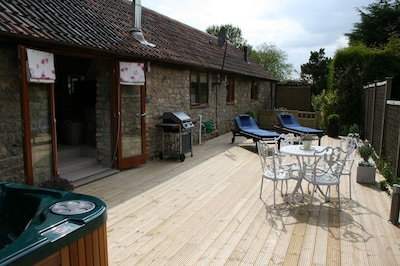 Decked area with hot-tub and BBQ