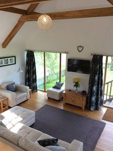 Double height ceilings, beams and oak floorboards