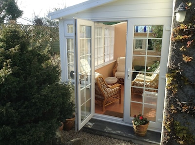 Comfortable conservatory for relaxing in.