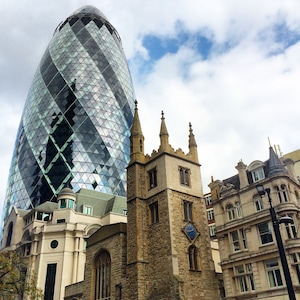 The 21st century Gherkin building stands next to St Andrew Undershaft Church.
