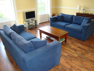 Living Room has two sofas, TV, dvd and one seat that becomes a single bed.