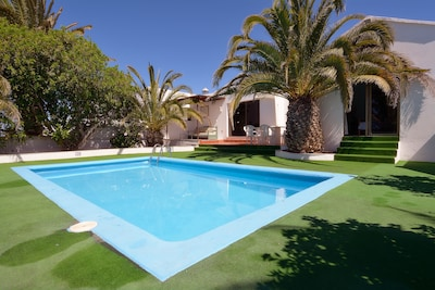 POOL WITH ASTROTURF SURROUNDING SWIMMING POOL