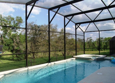 Pool area with spa & conservation views