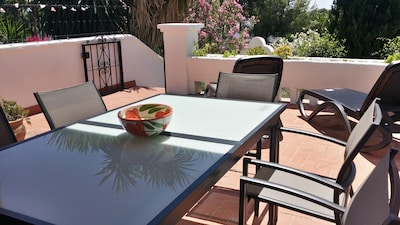 Casa 32's bright and spacious terrace, steps lead to the private garden