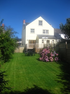 Enclosed back garden with balcony, BBQ and garden furniture