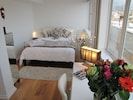 Bedroom with beach, city and sea views with private terrace outside