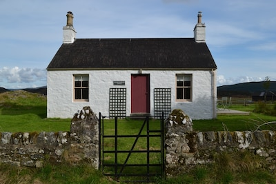 Charming cottage in an idyllic peaceful location with loch views.