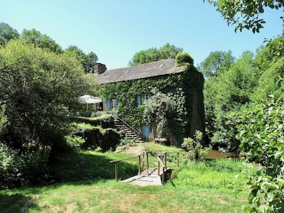 The mill viewed from the swimming pool, with the river to the right