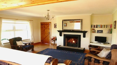 The living area with open fireplace in Carrickfinn Cottage. Free WiFi available