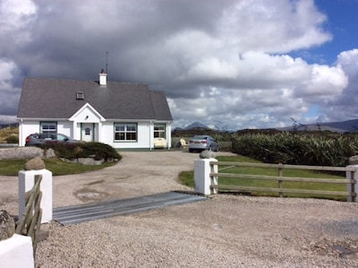 Carrickfinn Cottage with majestic Mt. Errigal in the background.