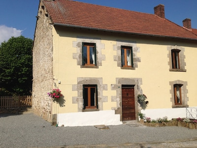 Meadow View Gîtes, Bluebell Cottage, front view with parking to the side.
