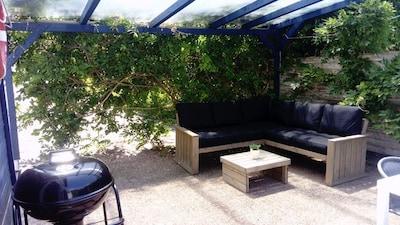 Salon sous terrasse couverte