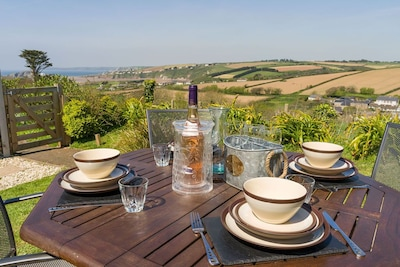 DINNER IN THE GARDEN WITH THE WONDERFUL VIEW ACROSS THE VALLEY AND OUT TO SEA