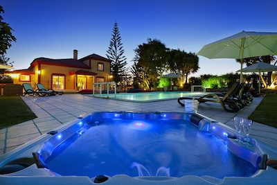 Jacuzzi and pool night-time