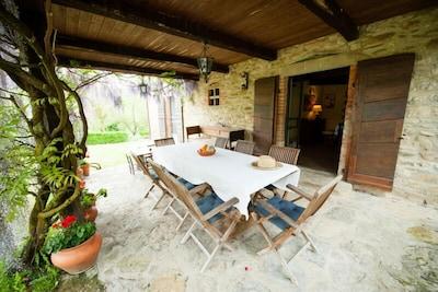 Dine al fresco under the pergola immediately outside the kitchen