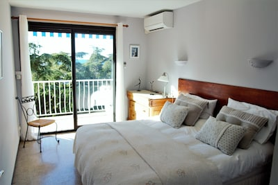 Double bedroom with balcony and view over the communal garden towards the sea