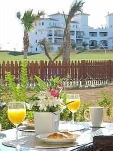 Terrace view of pool and golf course