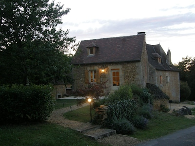 cottage  and garden at dusk