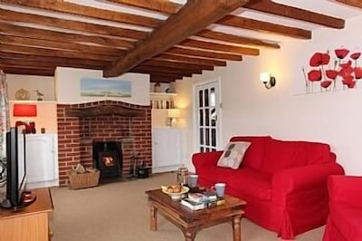 Lounge with comfortable sofas & wood burning stove