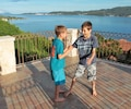 Kids on upper balcony with view