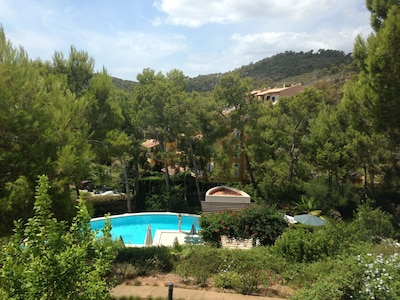 View over our shared pools & pine forested hills beyond, taken from our balcony