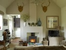 Antlers from nearby Grimsthorpe Castle adorn the sitting room walls
