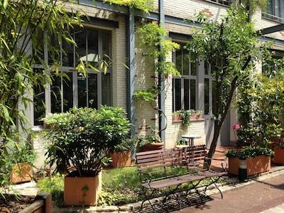 Jardin privatif ( expo sud) donnant sur cour arborée