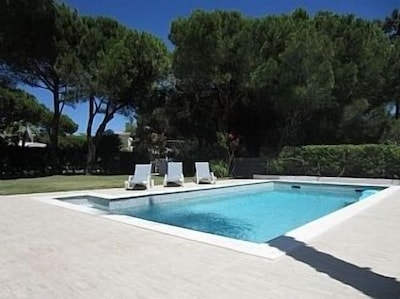 Pool area with large lawned area