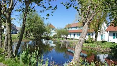 Ferienhaus im Weiler D mit Teichanlage