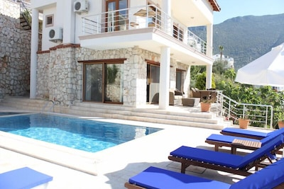View of villa with new sunbed and patio furniture - April 2014