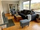 Das Wohnzimmer mit TV Flat, WLAN und Panorama- Fenster