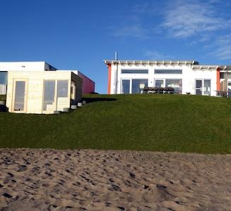 Ferienhaus FH1 am Mühlfeldsee mit Sauna am Strand