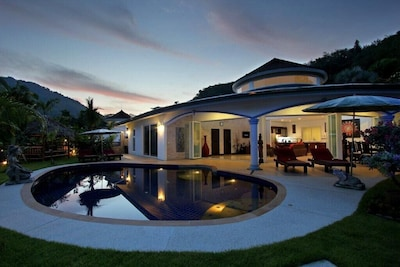 Front view of your villa with private pool at sunset