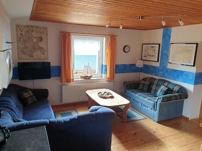 Wohnzimmer mit ausziebarer Schlafcoach